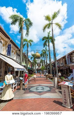 SINGAPORE - MARCH 22 2017: Vertical picture of the way with many restaurants to Masjid Sultan Mosque in Kampong Glam district of Rochor Planning Area in Singapore
