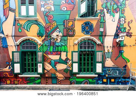 SINGAPORE - MARCH 22 2017: Graffiti art at the wall with nice windows of a restaurant at Haji Lane in Singapore