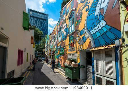 SINGAPORE - MARCH 22 2017: Wide angle picture of graffiti art at the wall of a restaurant at Haji Lane in Singapore