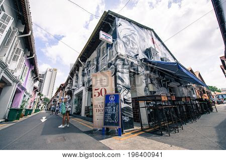 SINGAPORE - MARCH 22 2017: Graffiti art at the wall of a corner restaurant at Haji Lane street in Singapore.