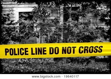 Police Line Do Not Cross Tape At Crime Scene House