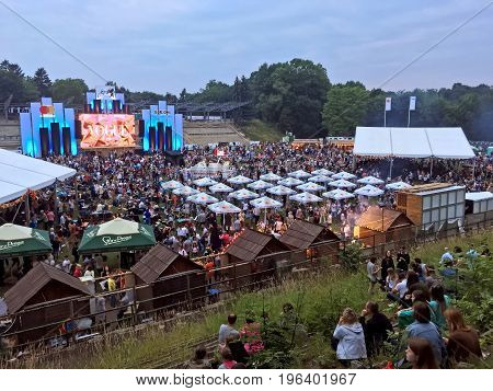 LVIV UKRAINE - JUNE 24: A large number of guests and viewers on Alpha Jazz Fest (at the stadium is specially equipped playground for free viewing events on the main stage of the festival) on June 24 2017 in Lvov Ukraine
