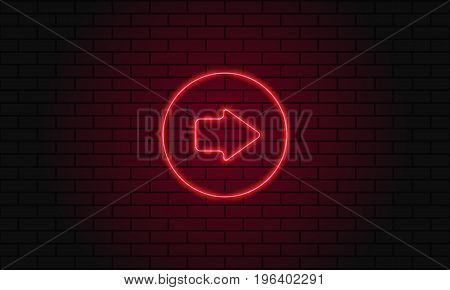 Neon Sign Arrow In A Circle On Brick Wall Background.