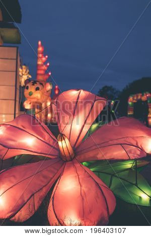 BALI, INDONESIA - JULY 8, 2017: Light festival on Bali island. Paper sculpture shining in the dark at a Asian lantern festival. Indonesia.