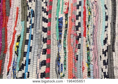Abstract textile background of coarse binding from different colors