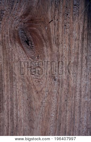 Old wooden surface with gnarl for use as background.