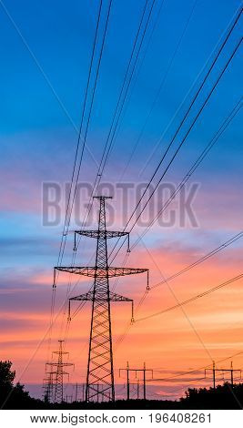 silhouette engineer repair and electrical installation work on high voltage pylons over