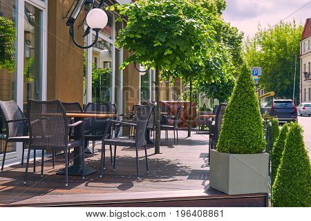 Tables In A Summer Cafe