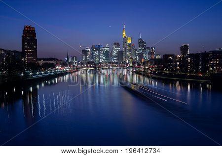 Frankfurt am Main, Hessen, Germany - March 16, 2017: Frankfurt am Main city skyline during blue hour in Frankfurt, Germany