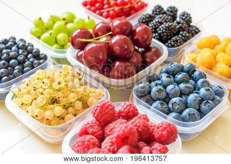 Collage Of Different Fruits And Berries Isolated On White. Blueberries, Cherries, Blackberries, Grap