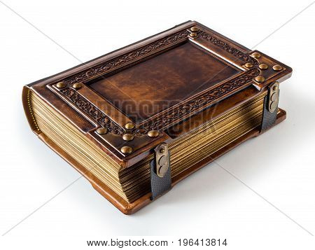 Isolated aged leather book with brass corners