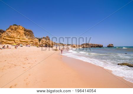 Beautiful View Of Sand Beaches With Rocks Washed By Atlantic Ocean On Sunny Summer Days. Summer Voca