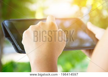 close up image of using digital tablet,Doing business the modern way concept background