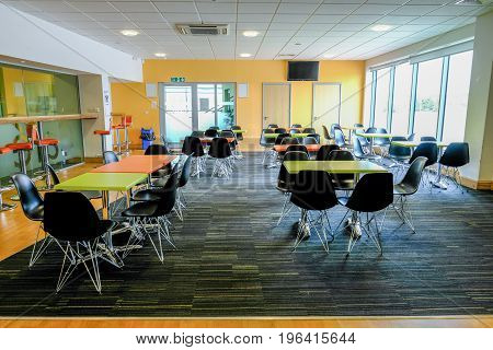 Essex England UK -June 12 2017:Empty canteen with tables and chairs. Light and airy room.