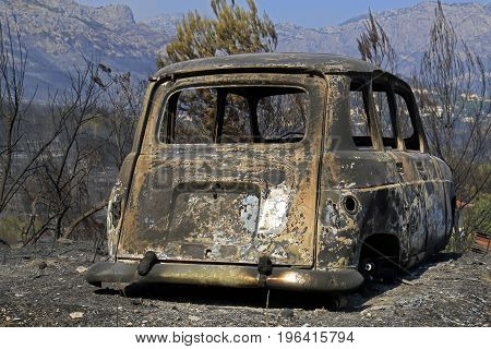 Koresnica Split Croatia - July 18 2017: Burned car after massive wildfire burning down the forest and villages around city Split