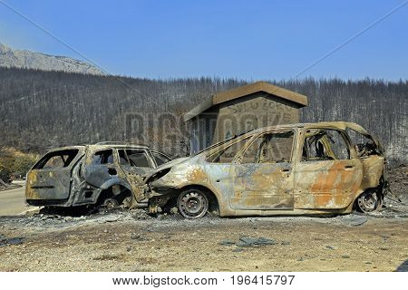 Kucine Split Croatia - July 18 2017: Burned cars after massive wildfire burning down the forest and villages around city Split