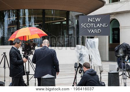 London, UK - 5 June 2017: Journalists and reporters await a press release outside New Scotland Yard in Westminster. This is the headquarters for the Metropolitan Police Force.