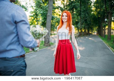 Romantic date, young couple meeting in summer park