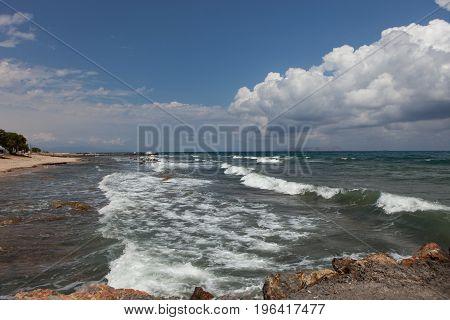 Crete; Analipsi; Greece; sea; Mediterranean; Mediterraneum; sea view; marine; species; seascape; water; waterscape; cloud; traveling; travel; journey; landscape; outdoor; waves; stones; summer; foam Sea surf quay