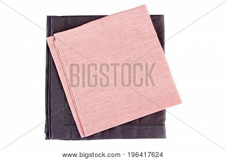 Folded gray and pink textile napkins isolated on white background