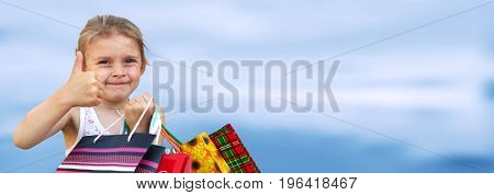 Little girl with shopping bags. Ok over blue background