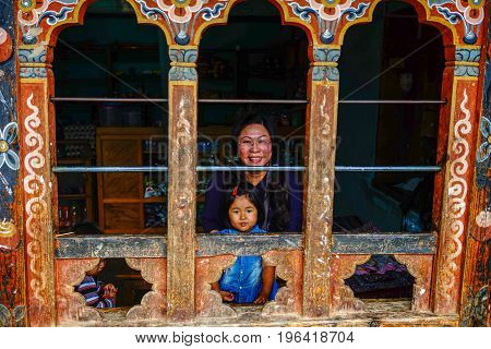 A Tibetan Woman With Her Child In Bhutan