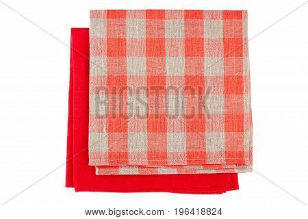 Red and checkered red textile napkins isolated on white
