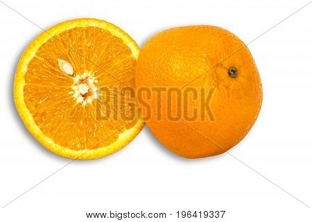 Orange with seed cut in half on white background