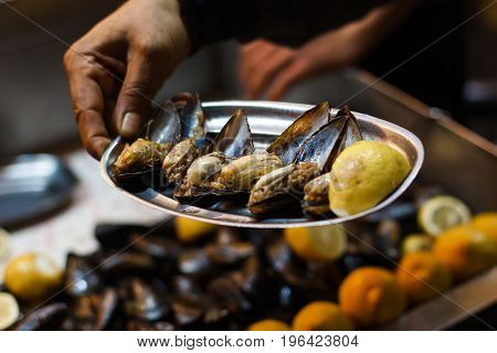 Stuffed mussels, turkish food mussels with rice street food.