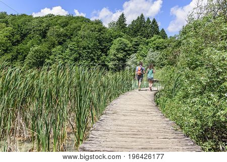 CROATIA PLITVICE, 29 JUNE 2017: Tourists walking along the wooden walkways in Plitvice Lakes National Park, Croatia.