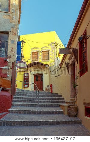 An old narrow street and a staircase in the city Chania. Crete. Greece.