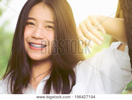 Close-up portrait image of beautiful teenager girl happiness in nature garden