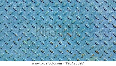 Texture of old metal diamond plate covered with blue paint