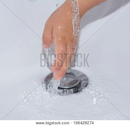 Child washing hand with water for hygiene