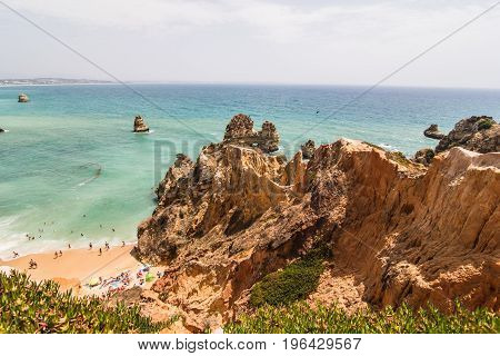 Beautiful Atlantic Ocean View Horizon With Sandy Beach Rocks  With Stairs On Beach On Atlantic Ocean