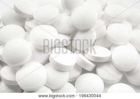 Health care concept. Round pills, closeup