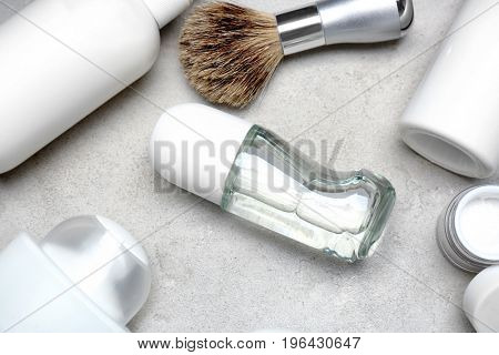 Various cosmetic products with deodorant for men on light background