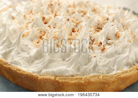 Delicious coconut cream pie with whipped cream, closeup