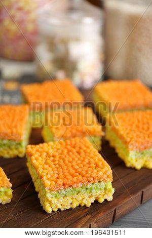 Rice crispy treats on wooden board