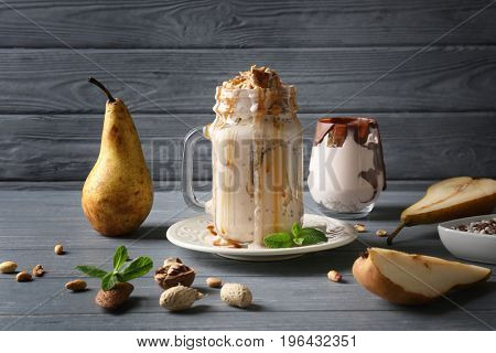 Delicious yogurt parfait in jar and ingredients on table