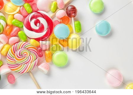 Tasty colorful candies on white background