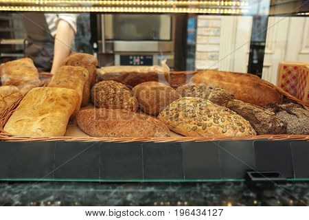Counter with bakery products in shop, closeup