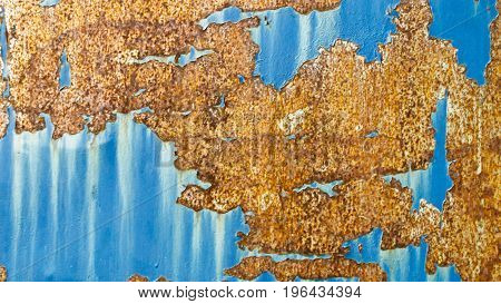 texture of rust pattern on blue metal background.