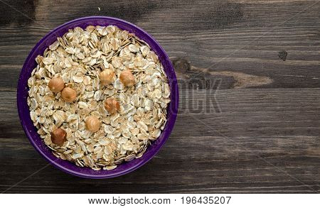 Oatmeal With Nuts Hazelnuts. Oatmeal On A Wooden Table. Oatmeal Top View. Healthy Food .