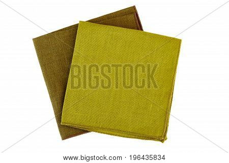 Two green textile napkins isolated on white background