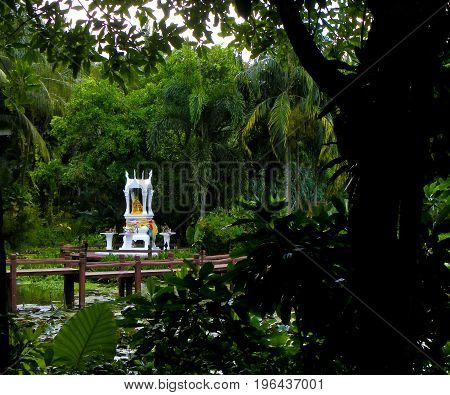 Buddhist temple shrine, small temple shrine in middle of small lagoon in Phuket Thailand.