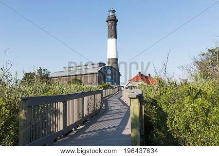The Fire Island Lighthouse looking up from the boardwalk as you approach the lighthouse on a bright sunny July late afternoon