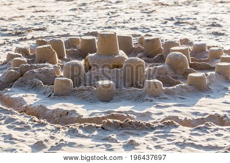 Children City From Sand On Beach In Sunlight