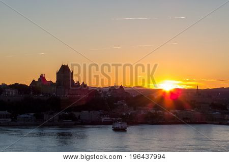 Distant sunset near the Chateau Frontenac and the Saint-Lawrence River. Quebec, Canada.