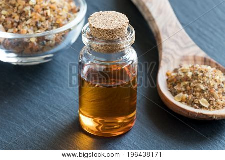 A Bottle Of Myrrh Essential Oil With Myrrh Resin
